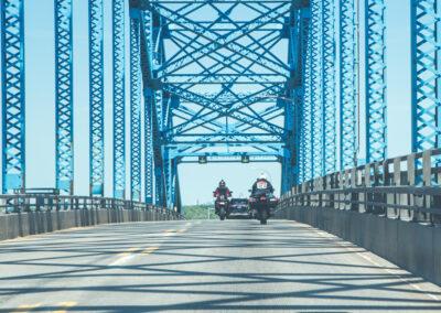 motorcycles on bridge